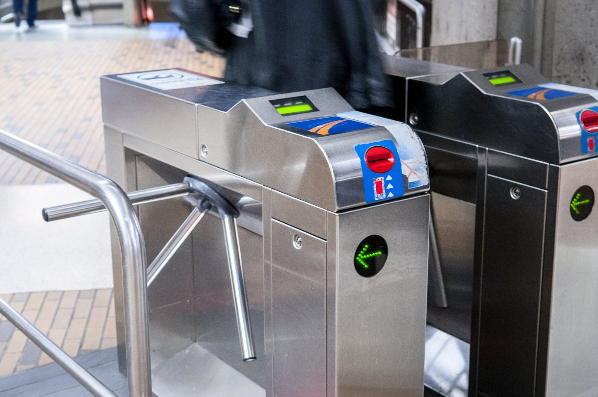 Montréal turnstiles, with a card reader on the top, and an ATM-like card insertion slot on the front side.